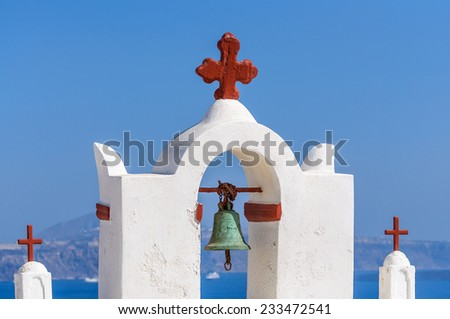 Bell tower of church above the beautiful blue bay at Santorini,Greece - stock photo