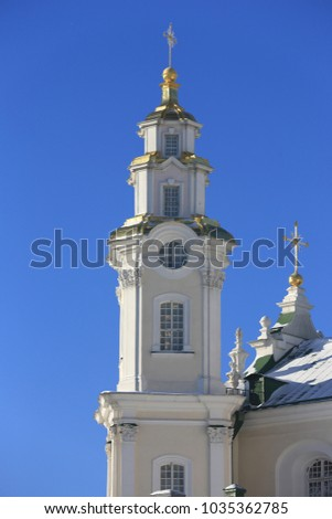 Bell tower of Holy Dormition Pochayiv Lavra in the morning sunlight, Ukraine