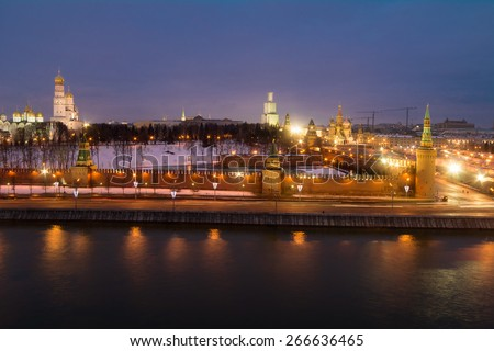 Bell tower of Ivan Great, Kremlin wall, Cathedral of St. Basil, Moskva river at evening in Moscow - stock photo