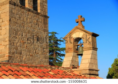 Bell tower of orthodox monastery near the Adriatic sea - stock photo