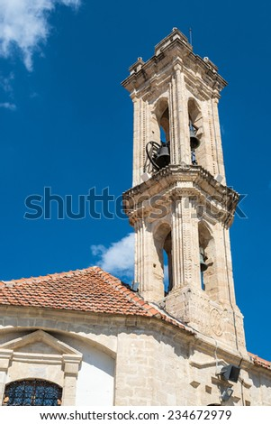 Bell tower of The Church of the Holy Cross, in the village of Omodos in the Troodos mountains, Cyprus. - stock photo