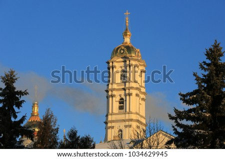 bell tower of the Holy Dormition Pochayiv Lavra in the morning sunlight, Ukraine