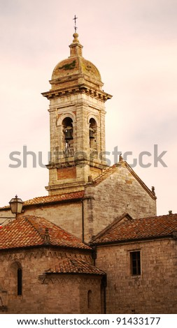 Bell tower with sweet vanilla sky in the evening. - stock photo