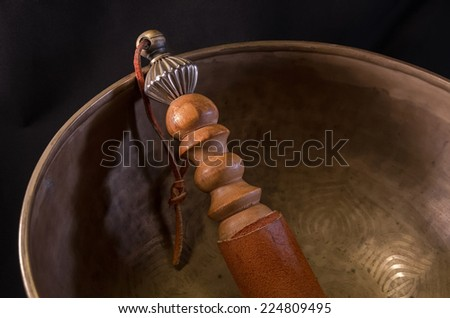 Bell used during buddhist prayers and also in alternative medicine - stock photo