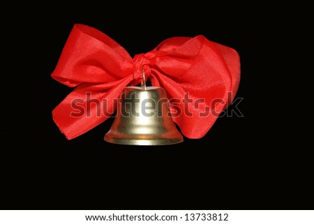 Bell with ribbons on black - stock photo