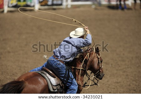 BELLE FOURCHE, SOUTH DAKOTA - JULY 4:  Tie-down roping competition at the 90th annual Black Hills Roundup rodeo in Belle Fourche, South Dakota July 4, 2009. - stock photo