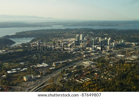 Bellevue and I-405 with Lake Washington and the Olympic Moutains in the background - stock photo