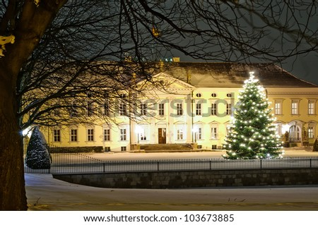 bellevue palace in berlin in winter at night with christmas tree - stock photo