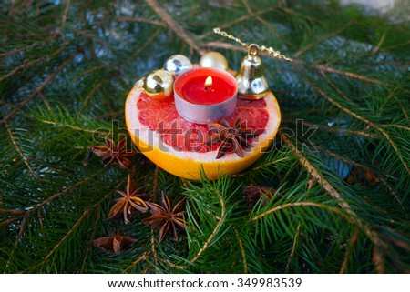 bells,candle,green background,grapefruit,christmas time,christmas,marry christmas,badian,needle - stock photo
