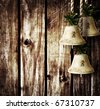 bells on wooden wall - stock photo