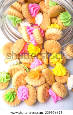 Belly button iced gem biscuits in a glass jar - stock photo