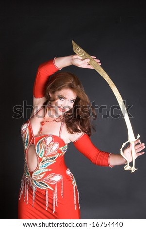 Belly Dancer wearing a red costume with jewelery - stock photo