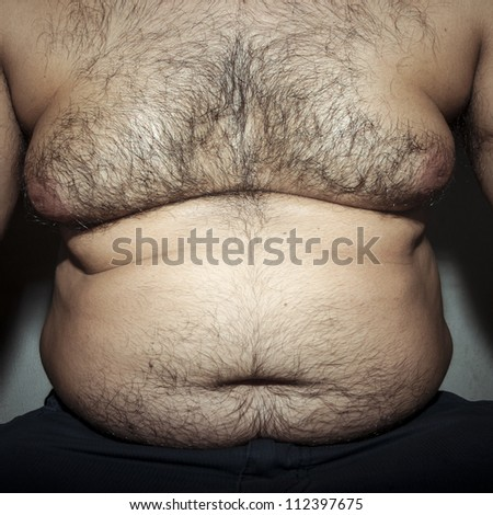 belly fat and hairy man with hands - stock photo