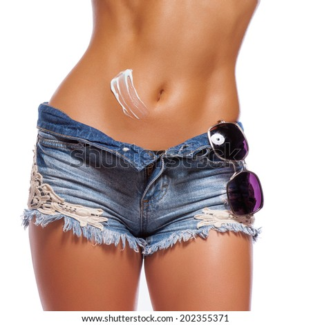 belly of a beautiful woman on white background - stock photo