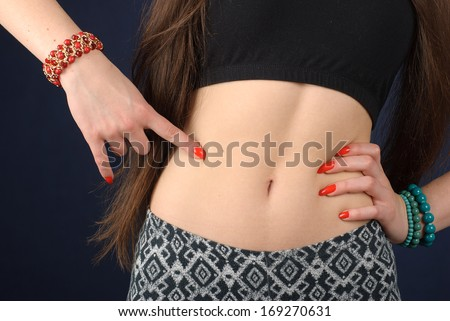 Belly of a young slim woman
