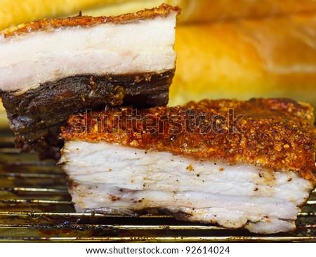 Belly pork roasting on the oven rack, Vietnamese cuisine - stock photo