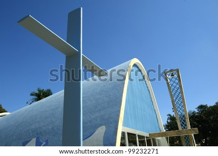 BELO HORIZONTE, BRAZIL - JULY 22: A cross lies outside the church of Sao Francisco de Assis July 22, 2005 in Belo Horizonte, Brazil. Built by Oscar Niemeyer it is also known as the Church of Pampulha. - stock photo