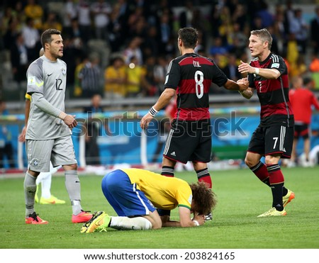 BELO HORIZONTE, BRAZIL - July 8, 2014: Cesar of Brazil and Oezil, Schweinsteiger of Germany during the World Cup Semi-finals game between Brazil and Germany at Mineirao Stadium. NO USE IN BRAZIL.