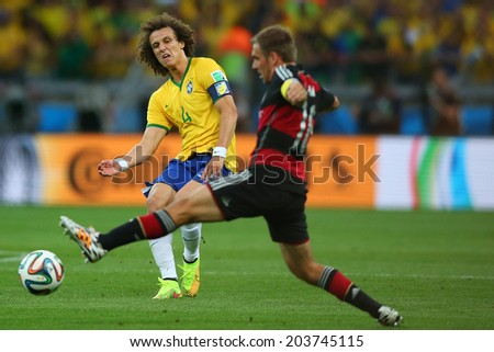 BELO HORIZONTE, BRAZIL - July 8, 2014: David Luiz competes for the ball during the 2014 World Cup Semi-finals game between Brazil and Germany at Mineirao Stadium. NO USE IN BRAZIL.