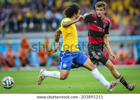 BELO HORIZONTE, BRAZIL - July 8, 2014: Marcelo of Brazil and Mueller of Germany compete for the ball during the Semi-finals game between Brazil and Germany at Mineirao Stadium. NO USE IN BRAZIL.