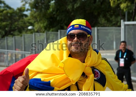 BELO HORIZONTE, BRAZIL - JUNE 14: Colombian fan outside the stadium supporting his national team during Colombia's first game of the 2014 FIFA World Cup in Brazil against Greece, on June 14, 2014  - stock photo