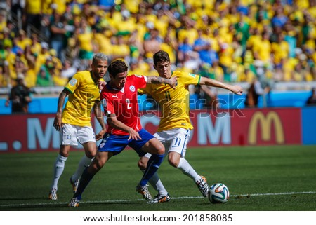 BELO HORIZONTE, BRAZIL - June 28, 2014: Eduardo Vargas of Chile competes for the ball during the World Cup Round of 16 game between Brazil and Chile at Mineirao Stadium. No Use in Brazil.