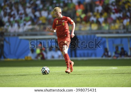 BELO HORIZONTE, BRAZIL - June 17, 2014: Kevin DE BRUYNE of Belgium, compete for the ball during the World Cup Group H game between Belgium and Algeria at Mineirao Stadium.  - stock photo