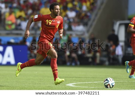 BELO HORIZONTE, BRAZIL - June 17, 2014: Moussa DEMBELE of Belgium compete for the ball during the World Cup Group H game between Belgium and Algeria at Mineirao Stadium. - stock photo