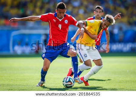 BELO HORIZONTE, BRAZIL - June 28, 2014: Neymar of Brazil and Isla of Chile compete for the ball during the 2014 World Cup Round of 16 game between Brazil and Chile at Mineirao. No Use in Brazil.