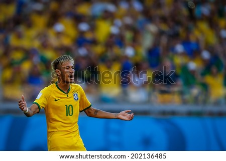 BELO HORIZONTE, BRAZIL - June 28, 2014: Neymar of Brazil during the penalty kicks at the 2014 World Cup Round of 16 game between Brazil and Chile at Mineirao Stadium. No Use in Brazil. - stock photo