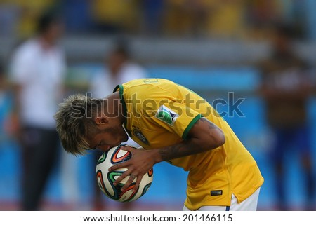 BELO HORIZONTE, BRAZIL - June 28, 2014: Neymar of Brazil preparing for a penalty kick during the 2014 World Cup Round of 16 game between Brazil and Chile at Mineirao Stadium. No Use in Brazil.