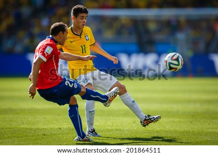 BELO HORIZONTE, BRAZIL - June 28, 2014: Oscar of Brazil competes for the ball during the 2014 World Cup Round of 16 game between Brazil and Chile at Mineirao Stadium. No Use in Brazil.