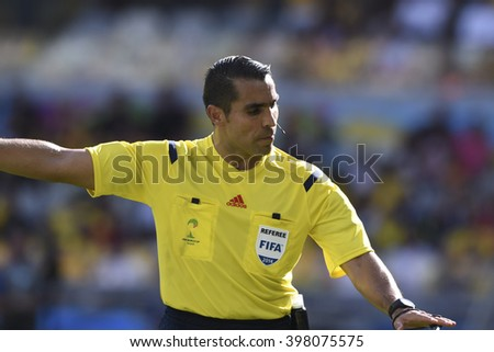 BELO HORIZONTE, BRAZIL - June 17, 2014: Referee RODRIGUEZ Marco (MEX) compete for the ball during the World Cup Group H game between Belgium and Algeria at Mineirao Stadium.  - stock photo