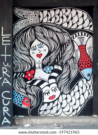 BELO HORIZONTE, BRAZIL - JUNE 8, 2014:  Street art by Ataide Miranda. Even with the lack of support, artists exhibit their graffiti work as a vibrant urban culture in streets of Belo Horizonte. - stock photo
