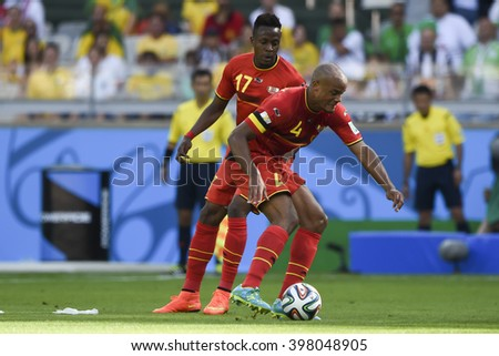 BELO HORIZONTE, BRAZIL - June 17, 2014: Vincent KOMPANY of Belgium compete for the ball during the World Cup Group H game between Belgium and Algeria at Mineirao Stadium.