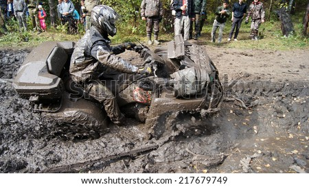 "Beloretsk,Bashkortostan,Russia - SEPT 13, 2014: Second stage of the seventh championship of the Republic of Bashkortostan trophy-RAID ""Sargassi 2014"" Quadrocycle is in the process of overcoming terrain."