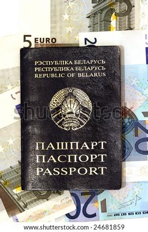 Belorussian passport on background of random euro banknotes - stock photo