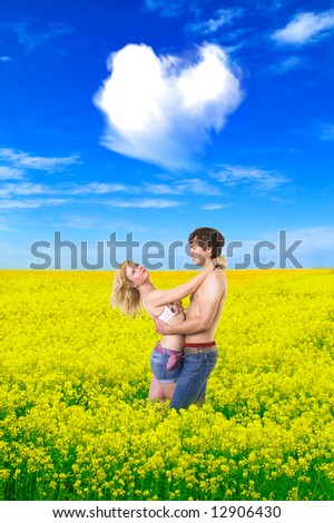 Beloved couple in the wheat field - stock photo
