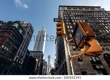 Below view from street on Empire state building in New York, USA - stock photo