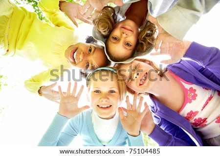 Below view of several happy girls standing head by head to each other - stock photo