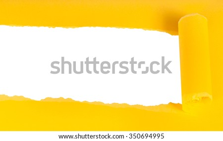 below view of yellow rolled-up torn paper on white isolated background - stock photo