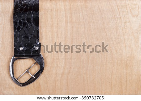 belt buckle on the background of wood texture