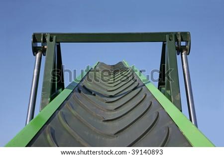Belt conveyor against the blue sky - stock photo
