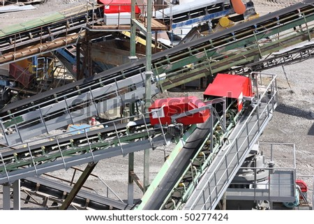 Belt conveyors and mining equipment in a quarry - stock photo
