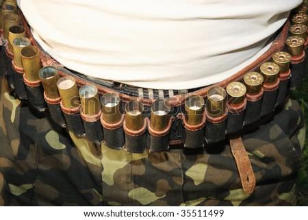 belt of ammunition on the belt of the hunter - stock photo