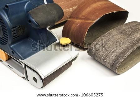 Belt sand on white background,wood tools - stock photo