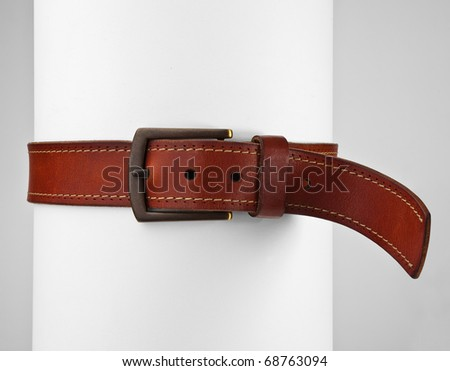 Belt tight around roll with clipping - stock photo