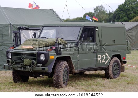 BELTRING, UK - JULY 27: A modern camouflaged Mercedes jeep stands on static display for the public to view at the War & Peace Revival show on July 27, 2017 in Beltring