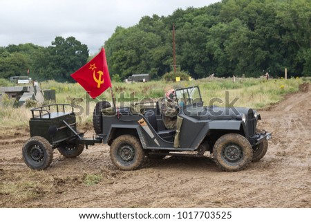 BELTRING, UK - JULY 26: An ex Russian army jeep and trailer heads around the main show arena for the public to view at the War & Peace Revival show on July 26, 2017 in Beltring