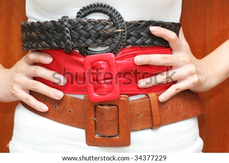 Belts around the waist (can be used for fashion or health concepts) - stock photo